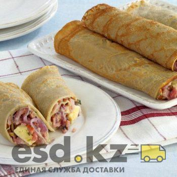 Buckwheat galettes stuffed with ham and cheese --- Image by © DK Limited/Corbis