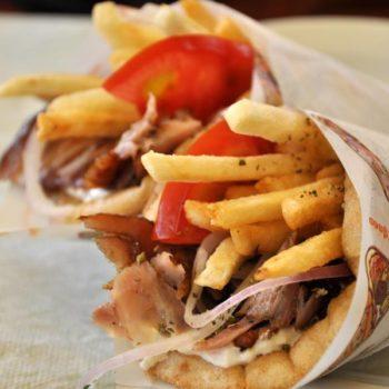 гиро греческий - 570тг пита, резаное мясо говядины, листик салата, картофель фри соус дзадзыки, помидор